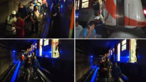 Usuarios caminan sobre las vías de la Línea 2 del Metro por falla eléctrica